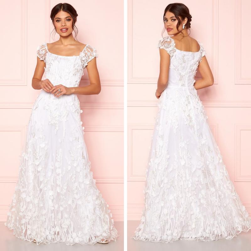 5f0fd4f675e2 ida sjöstedt vit spetsklänning bröllop